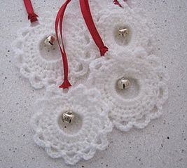 Christmas - Crochet pattern:  http://chalkygilbert.blogspot.de/2011/12/quick-and-pretty-crochet-garland.html  Made this with red yarn on a 36mm plastic ring and wove a piece of white yarn over and under the double crochet posts (tied with a bow).  This pattern is user-friendly, as there's no stitch counting aside from ch5.