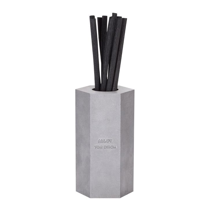 Tom+Dixon+Alloy+Reed+Diffuser+0.2L+-+Scented+reed+diffuser+in+cast+aluminium+hexagonal+vessel.  Release+the+fragrance+of+the+Tom+Dixon+Alloy+Reed+Diffuser+0.2L+into+your+home+interior+space.  Stirring+the+senses+with+its+enriching+metallic+facets+and+amber+wood+aroma,+this+hexagonal+shaped+reed+diffuser+is+perfect+for+lifting+stark+contemporary+settings.  Cast+from+a+steel+mould,+the+cast+aluminium+exterior+takes+its+hexagonal+profile+from+industrial+washer+bolts…
