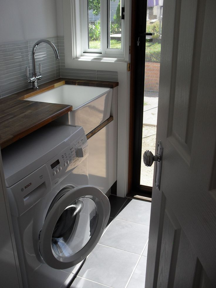 Beautiful country laundry with timber bench top and butler sink. http://www.restorationonline.com.au/sinks/kitchen-sinks/belfast-and-butler-sinks