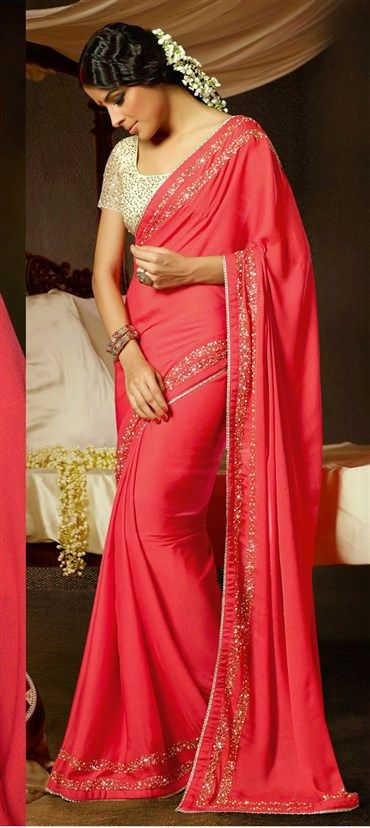 130140: Red and Maroon color family Saree with matching unstitched blouse.