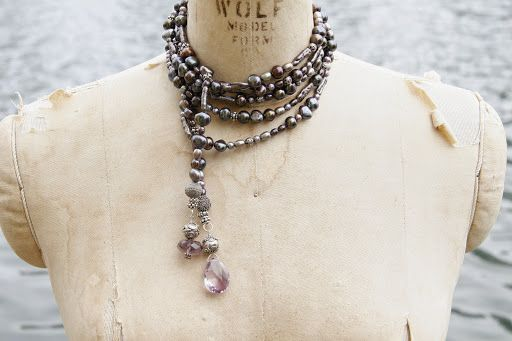 Long rope of freshwater pearls in shades of purple mixed with sterling silver beads and lilac amethysts. Wound into a choker.