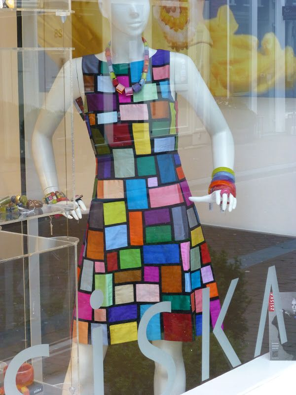 Mod patchwork dress, seen in a store window in Amsterdam.  Photo by Quiltmanufaktur.