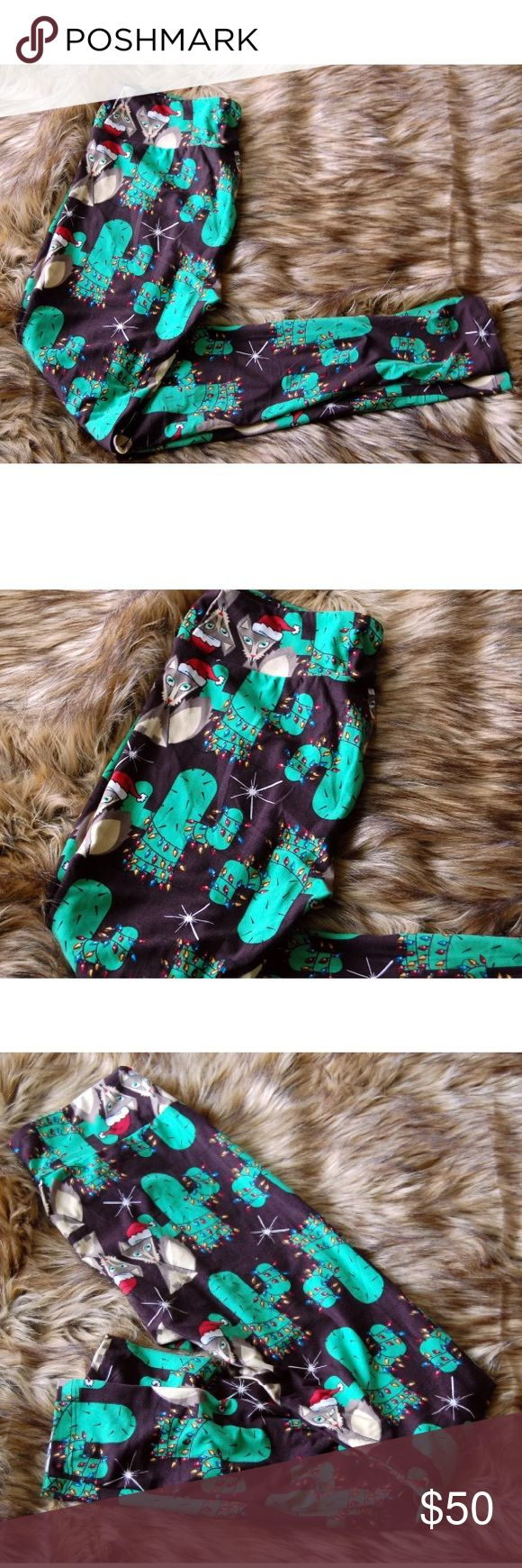 Lularoe cactus fox Santa Christmas leggings black New Lularoe OS Leggings Fox and Cactus in black Tag has been removed but never worn. LuLaRoe Pants Leggings