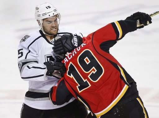 Iginla fights and scores, Kings beat Flames in chippy game  -  March 30, 2017:    Los Angeles Kings' Andy Andreoff, left, grabs the head of Calgary Flames' Matthew Tkachuk during the second period of an NHL hockey game in Calgary, Alberta, Wednesday, March 29, 2017. Andreoff gets an unsportsmanlike conduct penalty for grabbing Tkachuk's head. (Larry MacDougal/The Canadian Press via AP)