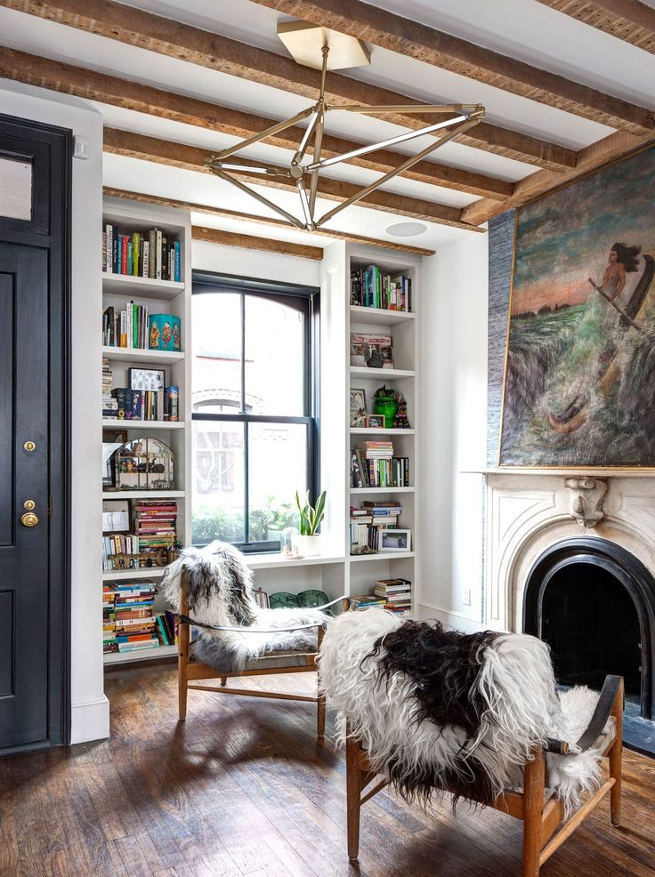 Those chairs and that fireplace are perfection beneath that geometric light fixture.