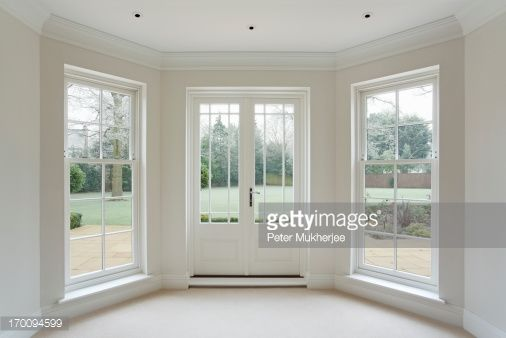 Stock Photo : white bay windows and French doors