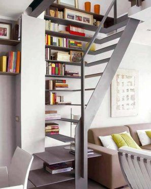 I kind of have always wanted a bookshelf-lined staircase. Maybe someday. Love this open, modern version.