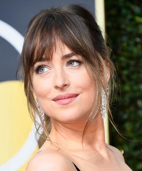 The best celebrity bangs for diamond faces: Slightly longer on the edges, Dakota Johnson's bangs are the epitome of versatility: Just toss them to the side or part them in the middle for a quick change. However worn, they'll work wonders balancing a stronger chin.