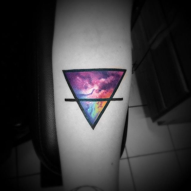 Vibrant colour cosmos-look tattoo, Chris Purdy.