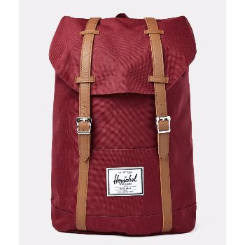 Burgundy Retreat Backpack: Burgundy retreat backpack. The Retreat range is like a shrunken version of Herschel's Little America range. It's given a reinforced bottom, laptop sleeve and contoured shoulder straps for added comfort. Fully lined with signature coated cotton-poly fabric. Magnetic strap closure. Up to 15'' laptop sleeve. Reinforced bottom. External sleeve pocket.