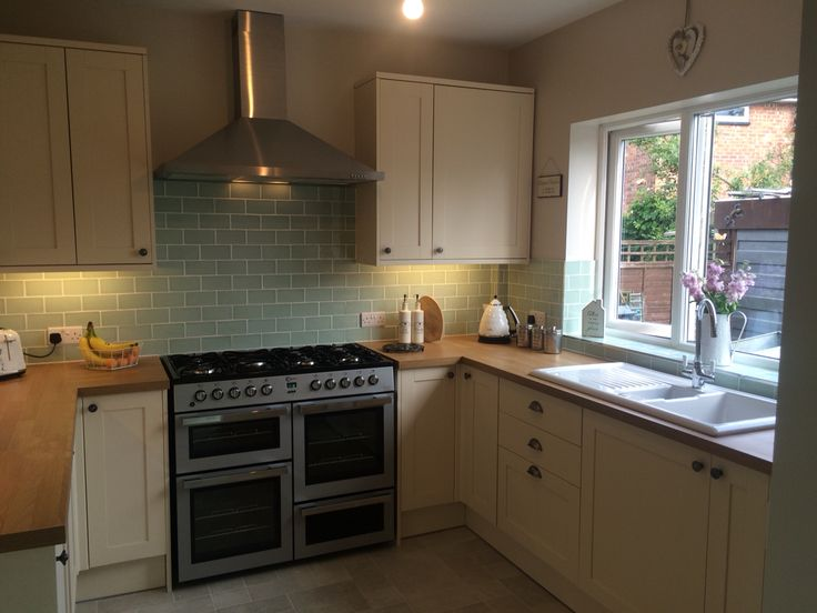 Our new kitchen :-) Howdens Greenwich shaker cream and Laura Ashley Eau De Nil…