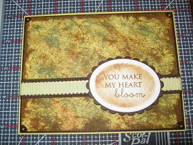 I followed Gina's video on Stamp TV to reproduce this card. I did not have all the supplies that she used, mainly the distress inks, so I h...