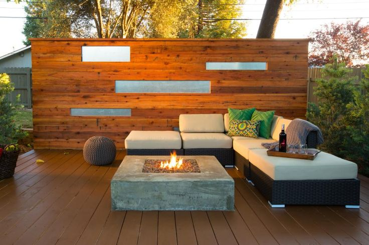 The simplicity of this Asian-inspired design helps crate a tranquil setting on the deck. The fire pit is surrounded by comfortable seating and a privacy wall.