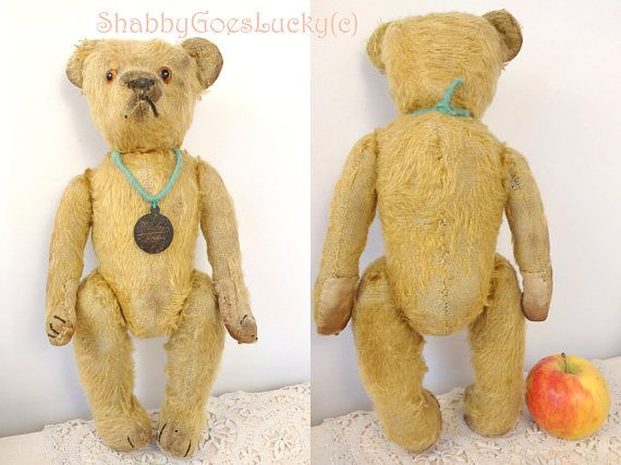 Here is lovely antique teddy bear, well - loved in his time, restored, smiling &perfectlyshabby - chic! Our beautiful old teddy bear here was made by Petz (a famous German toy manufacturer, founded in 1859); in the late 1940s. We can tell because from 1947 on Petz bears & toys have a
