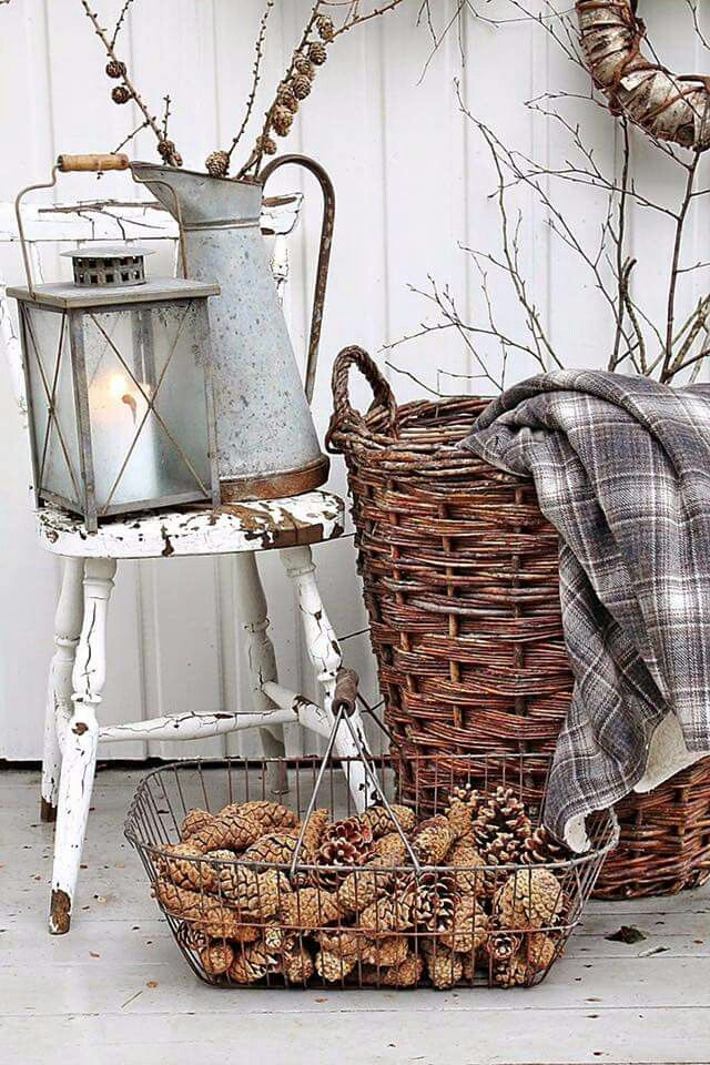 Neutral Winter Decor With Pinecones And Twigs And Chippy White Stool