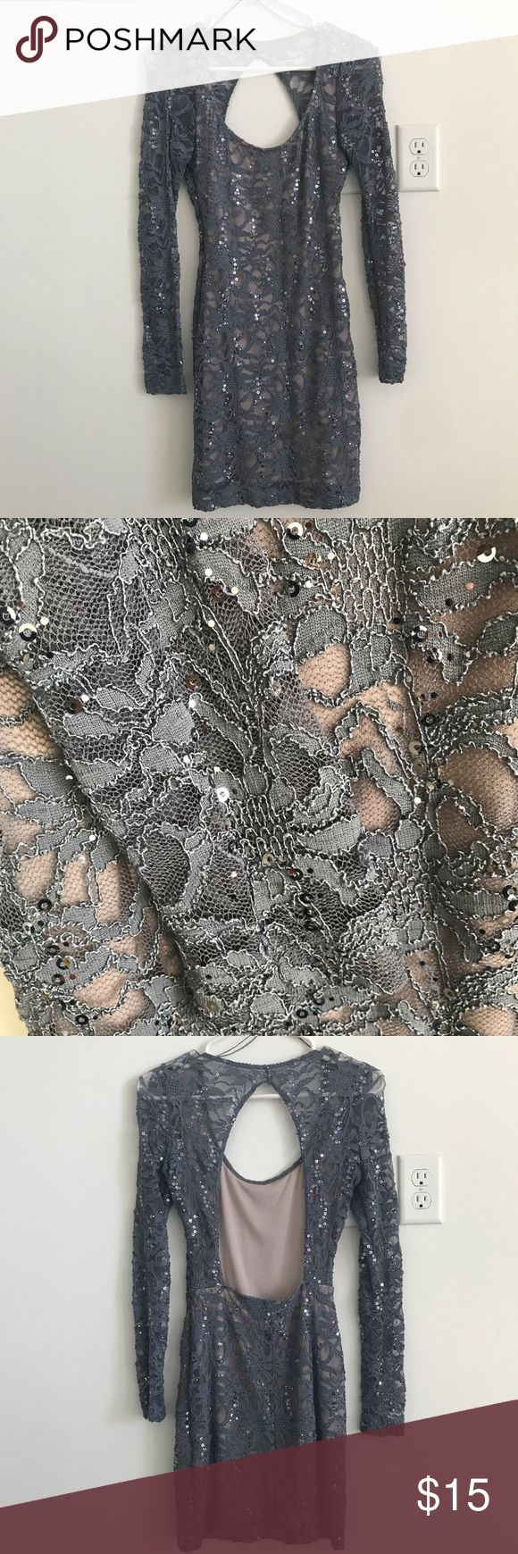 Sequins grey dress Sequins grey open back dress. The arms are lace see through while the body has a nude slip attached to it. It is above the knee for a petite person. Windsor Dresses Mini