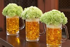 Beer Mug O' Blooms  I am totally making these for our pub themed St. Patty's Day party :)