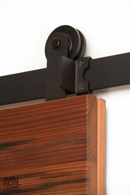 Our Aero Modern Flat Track Sliding Barn Door Hardware for interiors is a great DIY solution. Easy to install, craftsman-made in the USA, and fast shipping.