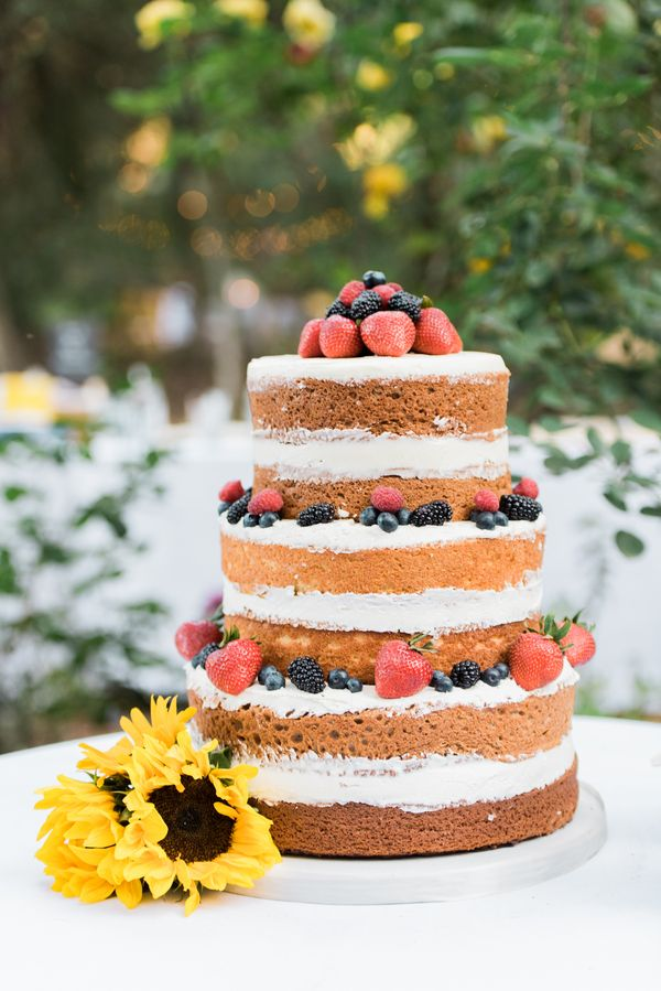 Delicious naked berry wedding cake. View the full wedding here: http://thedailywedding.com/2016/05/19/diy-forest-wedding-emmalinda-eric/