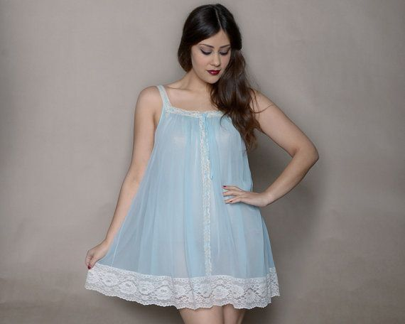 Vintage 60s babydoll nightie in baby blue has cream lace trim and straps. Mini nightie also features layered chiffon and bow tie at the