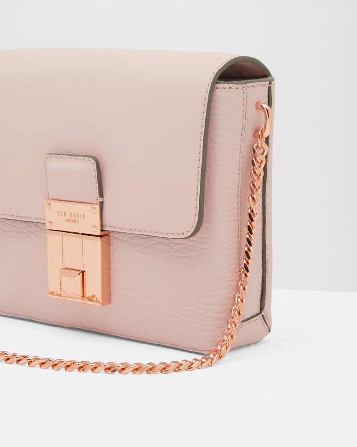 SHOP TRANS: When it comes to the BETTI cross body bag, less is certainly more. Made for the modern minimalist, this contemporary carrier can simply be draped over your shoulder for a simple yet sophisticated look.