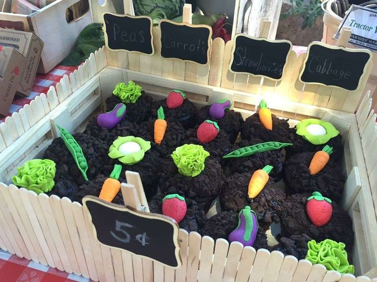 Veggie cupcakes in a garden at a Farmers Market birthday party! See more party ideas at CatchMyParty.com!