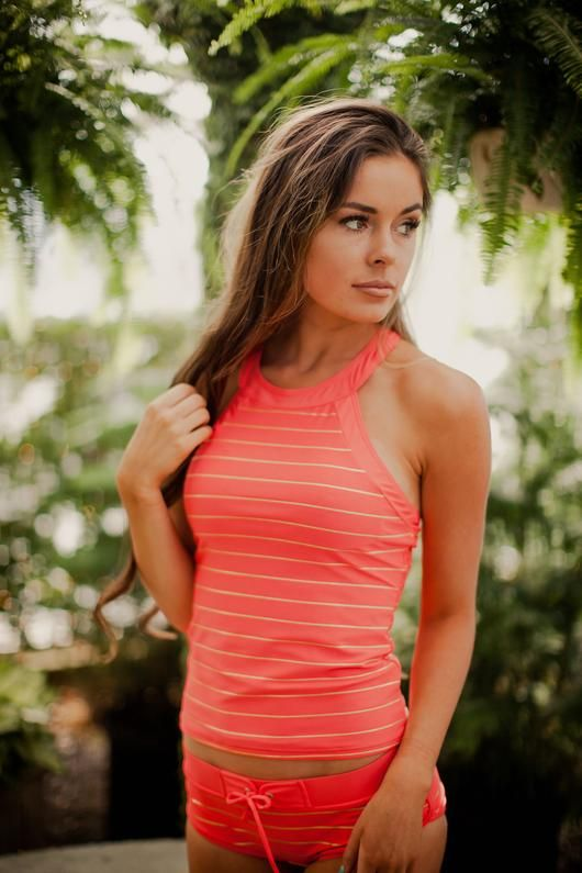 Your favorite suit, in CORAL! Here are a few of our favorite things about it: - Shiny, gold horizontal stripes - Comfortable + athletic - Sporty back with the embroidered RAD logo - Sewn-in padding th