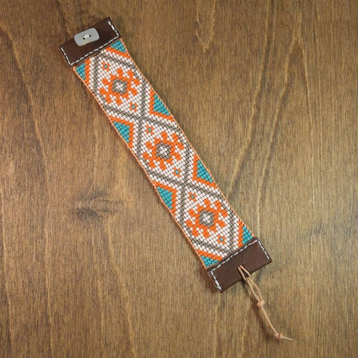 I've been bead weaving for a long time now.  It is one of my favorite crafting techniques. First it is extremely calming to weave and watch the pattern grow.  Second I love the texture of the finished piece that makes it look like a miniature mosaic.  This bracelet features a star pattern I designed inspired by woven kilim rug patterns I love so much.  For this cuff I used orange turquoise grey and white seed beads woven between greek leather cords for stability with a bright peach silk…