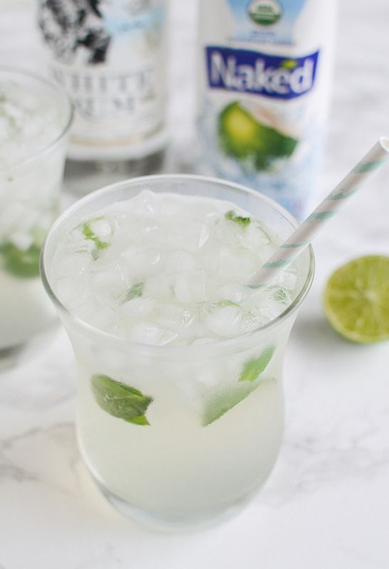 Skinny Coconut Mojito - the ultimate summer drink recipe! Coconut water, rum, limes, and mint! This is low calorie and so delicious!