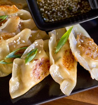 Recipe For Gingered-Chicken Pot Stickers with Sesame-Honey Dipping Sauce - Pot stickers are those delicious, delicate little Asian-style dumplings; those sumptuous, savory little pillows of love, that are simple to make a zippy little meal out of.