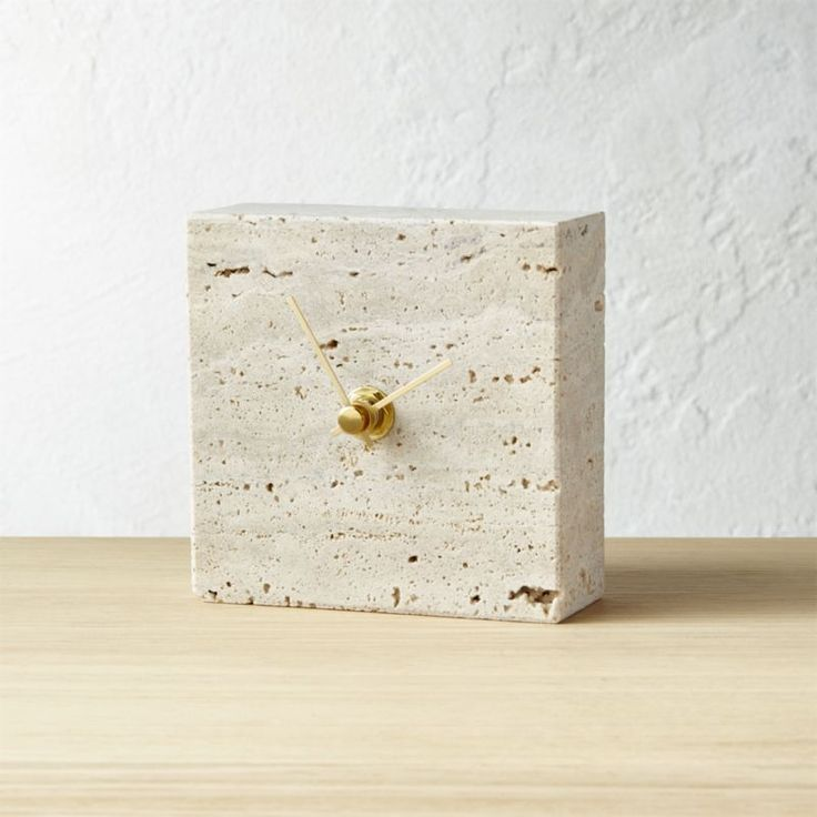Shop Travertine Stone Clock.  Natural stone squares away in neutral clock with classic style. Gold hands add fine finish. No numbers keep it graphic.