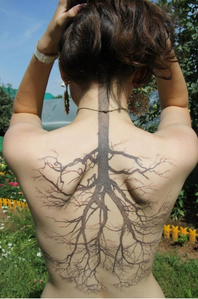 One of the most unique tattoo's I've seen! Tree Root Tattoo on her back