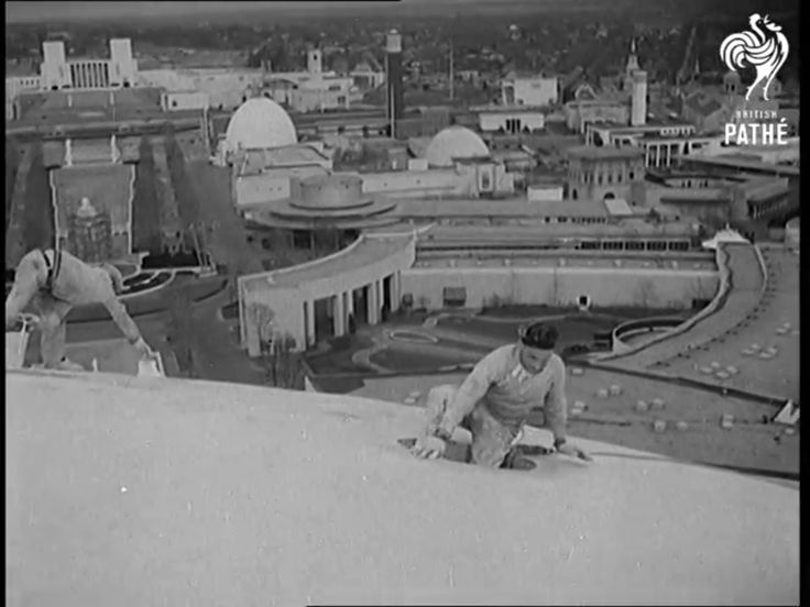 New York World's Fair 1939-1940: Workmen atop the Perisphere cleaning and whitewashing the surface. Screen capture from a 1940 British Pathe newsreel.