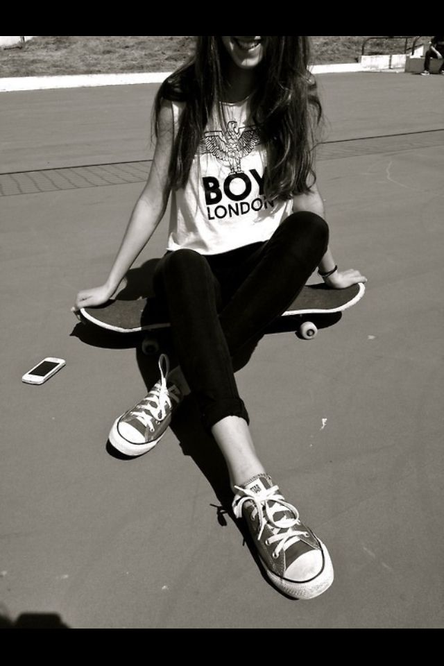 Street skater girl in Boy London tee