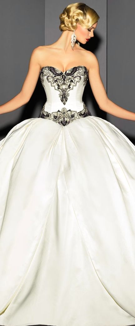Victor Harper gown. That top part is gorgeous and perfect!!! I just don't want a poofy princess gown. =/