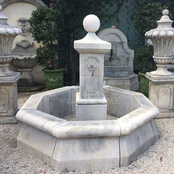 Charming octagonal garden fountain after a 17th Century original. The square fountain head has a recessed beveled field and a delicately hand carved flower on two sides. Hand carved in limestone, spouts are sold separately. Please visit our extensive spout selection to personalize this fountain.
