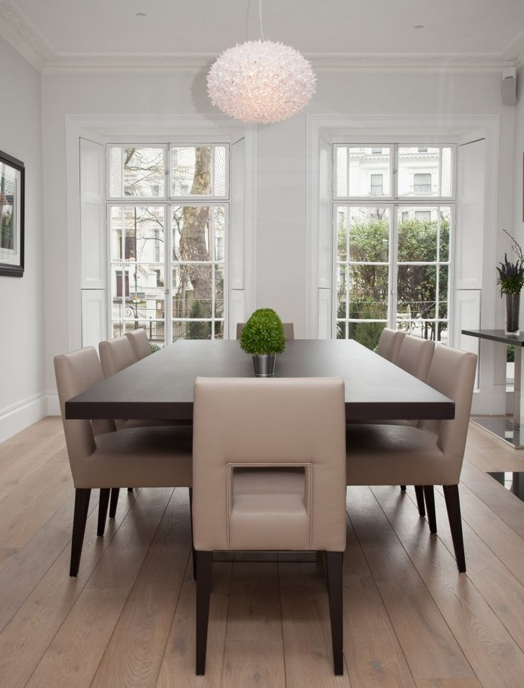The view from the head of the table, showing the pair of bay windows that look out on the front street. The light fixture is bright and contemporary; almost floral in design.