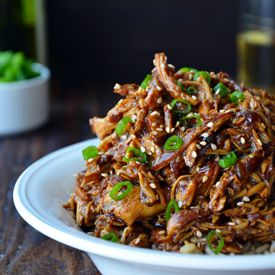 Slow Cooker Honey Garlic Chicken stars tender shredded chicken breasts tossed in a sweet and tangy sauce.