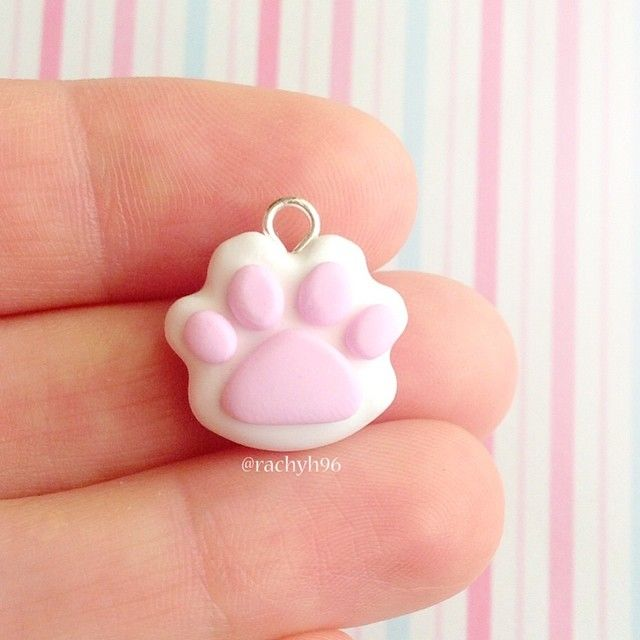 Hi everyone!  Here's a very simple, but cute paw print charm!  The one in this photo hasn't been glazed yet, but I will have some available on my shop soon which are super shiny and pretty! ✨ Hope you like it! ✌ #polymerclay #polymer #clay #cute #kawaii #animal #paw #pawprint #handmade #craft #sculpey #fimo #premo #pink