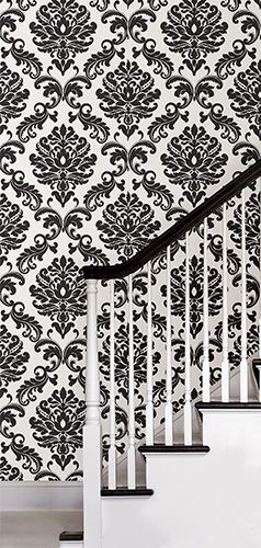 Black damask peel and stick wallpaper is the perfect solution for redoing your hallway. NuWallpaper is easy to apply and won't damage your walls when it's time to remove. It comes down in seconds!