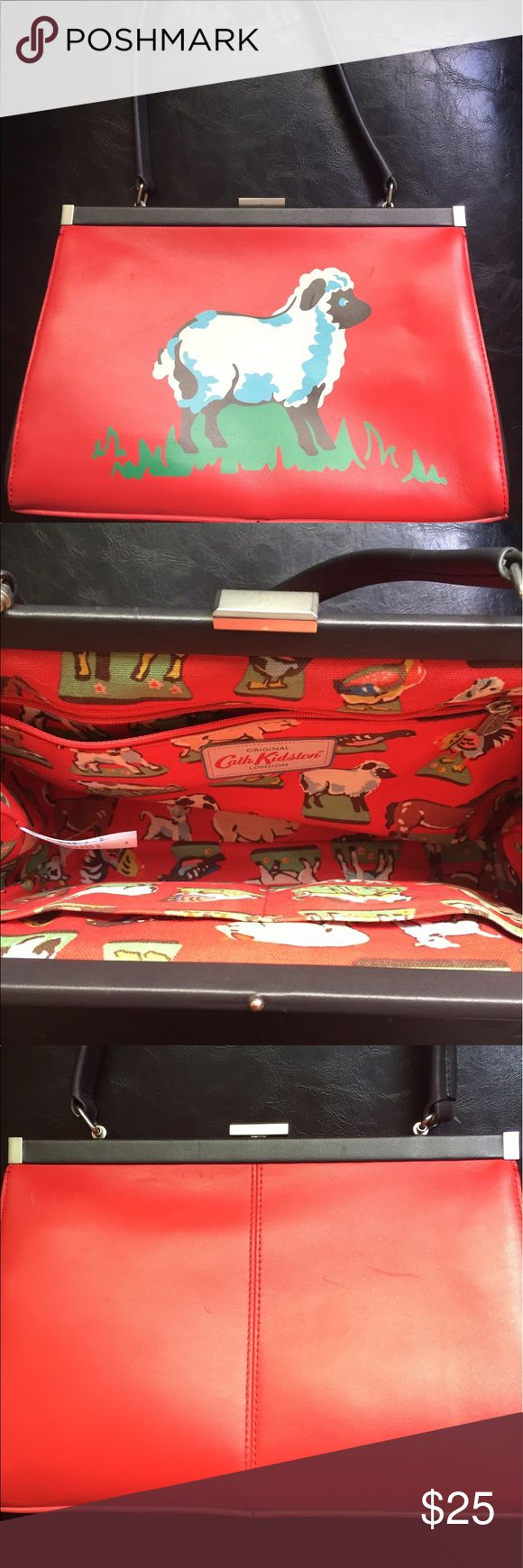 Red Leather Cath Kidston Purse Handbag with Lamb For sale is a red leather lamb Cath Kidston brand purse. The sheep motif has a slight scratch on it and there are a couple other very minor scratches on the bag, please see photos. Lined with a cheery cotton canvas, has an interior zip pocket, and a snap closure. Non-smoking home. Thanks for looking! Cath Kidston Bags Shoulder Bags