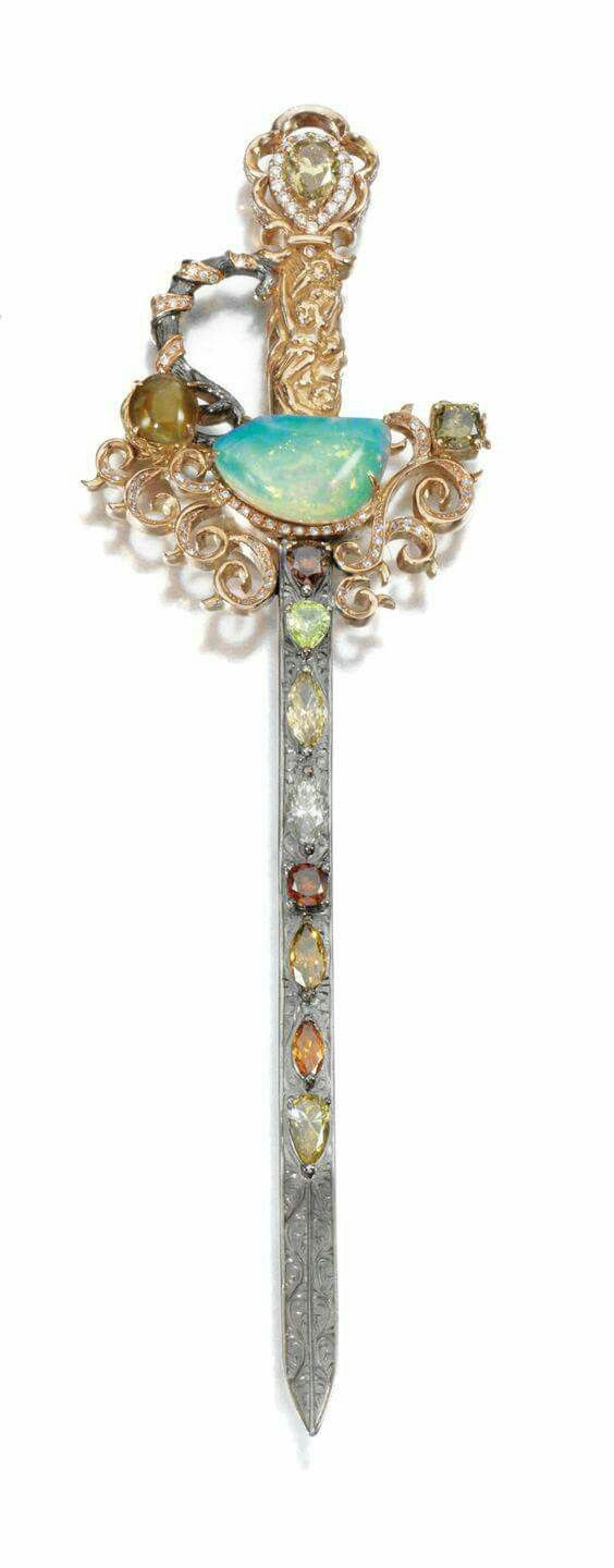 Sword brooch set tih opal, cat's eye chrysoberyl and diamonds of various colors. Signed Young 2009. Sold at Sotheby's... Just an FYI, I'll be covering some really cool new designers starting this year and filling you all in on how their designs coorelate to antique jewelry!