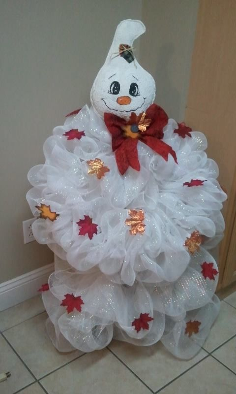 Deco Mesh Ghost using a tomato cage and round wire wreath for the arms.  Made by Angie Yeager