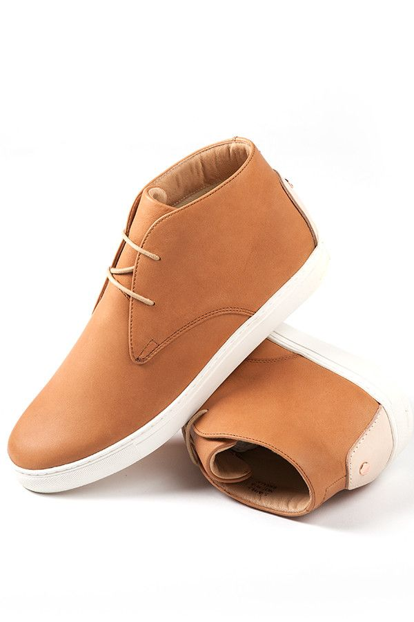 The Rodan, a classic Chukka boot trainer is crafted from lightly tanned baseball glove leather, which darkens naturally with the wearer over time. Upon completion, each shoe is thoroughly inspected an