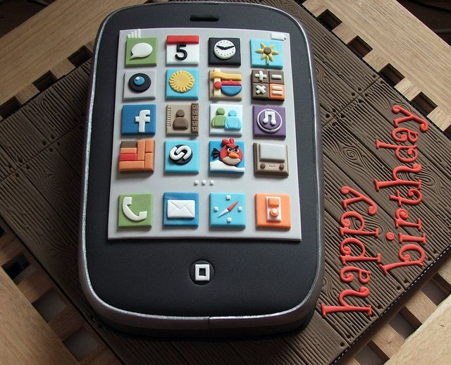 iPhone birthday cake by The Designer Cake Company. I should make one for Jimmy since he's such a huge Apple fan
