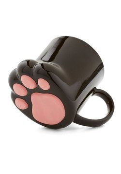 Pawsitively Bemused Mug. You love tackling the morning crossword puzzle with this black, cat-paw-shaped mug in hand. #black #modcloth