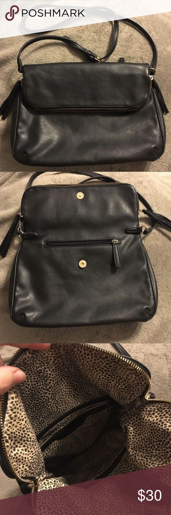 Francesca's Blck Foldover Crossbody Bag Gorgeous black foldover Crossbody. 1 zipper in the front, 1 on the back, and the main zippered compartment with 2 pockets inside. Used for a few weeks but good condition. My kitty scratched the bag but it's covered when the flap is down, pictured in 4th photo, and there is also some rubbing on the bottom corner - also pictured (and it looks worse in pictures than in person - it's pretty hard to notice). Adjustable Crossbody strap. Perfect for every…