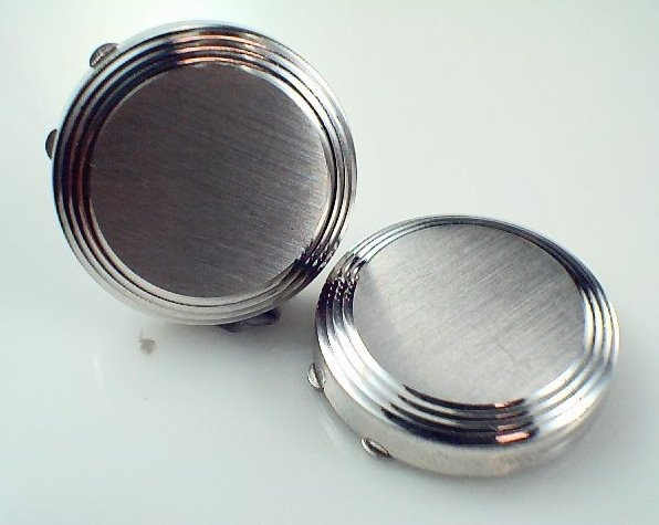 Don't have a shirt for cuff links ? How about these button covers that go over the any button.