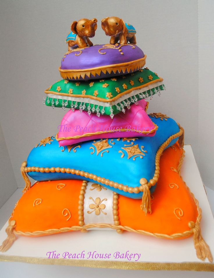 Indian pillows cake made for Diwali celebrations. Everything is handmade and edible except for the crystal fringe on green tier.