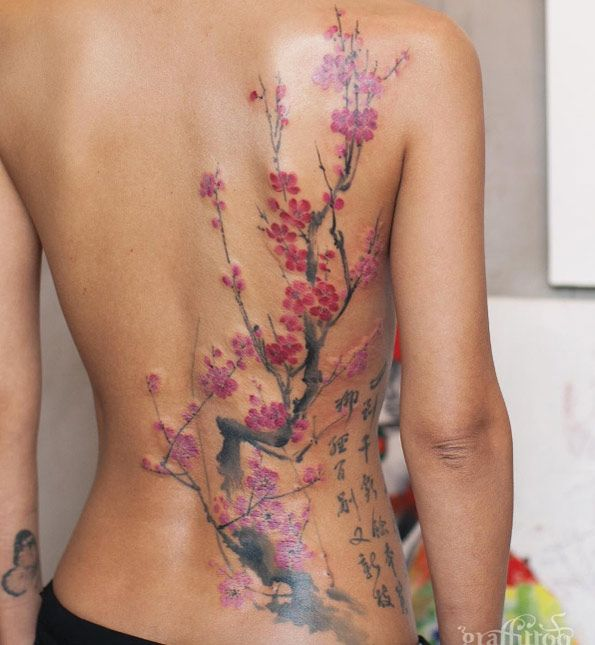 Large cherry blossom tattoo on back by Tattooist River